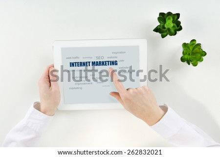 Word cloud in tablet. Internet marketing concept - stock photo