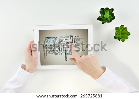 Word cloud in tablet. Search concept - stock photo