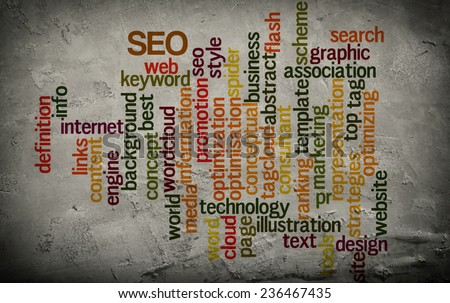 word cloud related to seo on grunge wall background - stock photo
