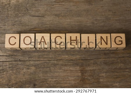 word coaching on wooden cubes - stock photo