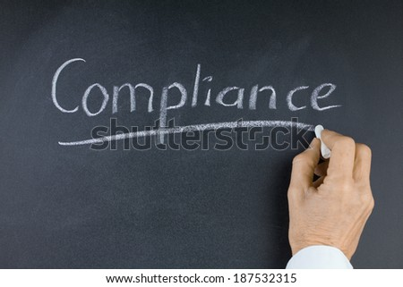 Word Compliance on Blackboard with Hand and Chalk