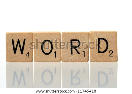 Word construction with scrabble blocks on white background - stock photo