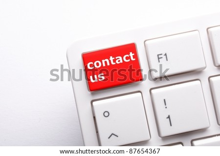 word contact us on red keyboard key - stock photo