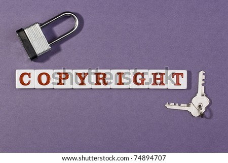 Word copyright on a purple background next to a lock and keys.