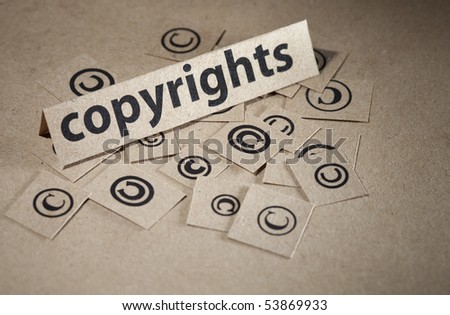 Word copyright with many symbols around written on paper - stock photo