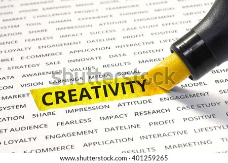 Word creativity highlighted with marker on paper of other related words. For direction of business strategy success concept - stock photo