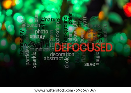 Word  DEFOCUSED with blurred light background.