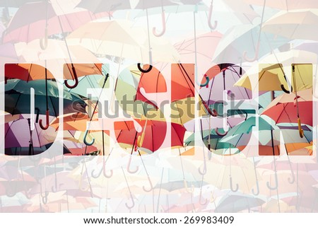 Word DESIGN over colorful umbrellas. - stock photo