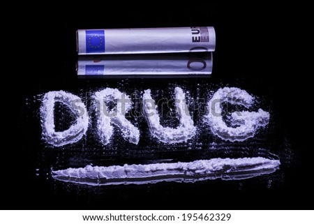 Word Drug, cocaine powder in line ready for insufflating and 50 euro note on a mirror  - stock photo