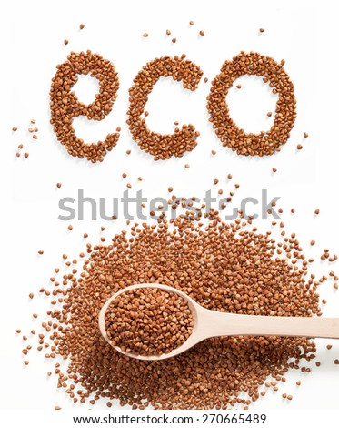 Word eco composed of premium buckwheat groats on white background with wooden spoon - stock photo