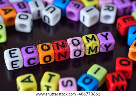 Word Economy surrounding by alphabets dice