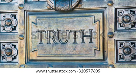 Word Engraved on Bronze Door with Truth - stock photo