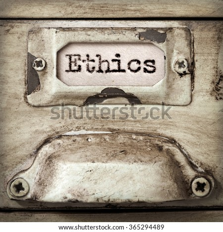 Word ethics on drawer label of vintage industrial filing cabinet. - stock photo