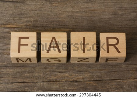 word fair on wooden cubes - stock photo