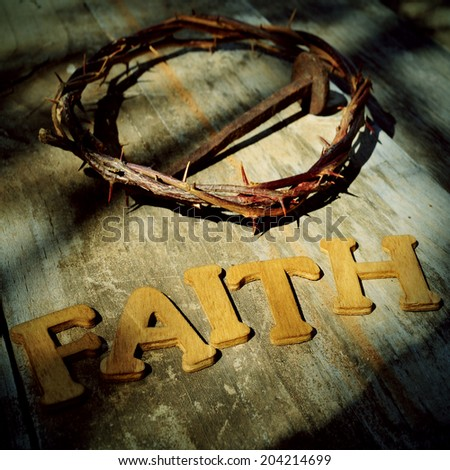 word faith and the Jesus Christ crown of thorns and a nail in the holy cross - stock photo