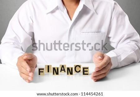 word Finance in hand, businessman - stock photo