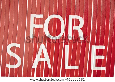 Word for sale on shredded paper