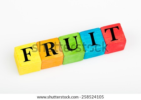 word fruit on colorful wooden cubes isolated on white background