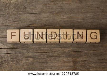 word FUNDING on wooden cubes - stock photo