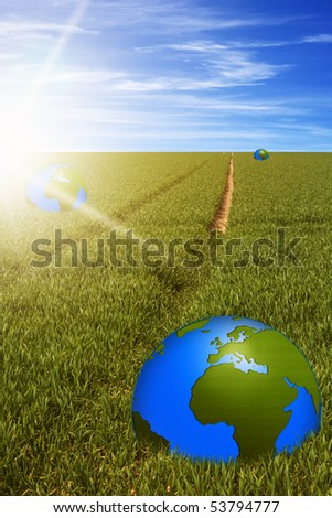 word globes in the green field with a path to horizon