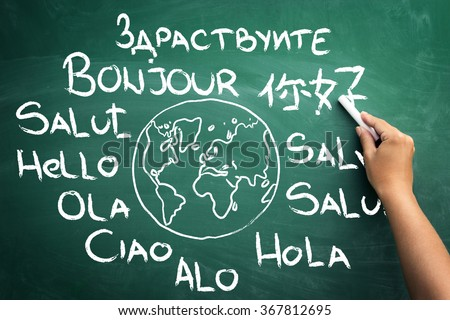 Word hello in all languages of the world on blackboard - stock photo