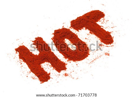 Word hot made of dry red pepper spice isolated on white background. - stock photo
