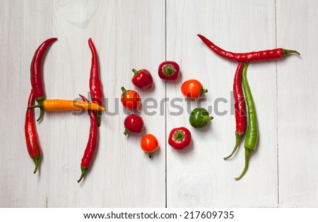 """Word """"hot"""" written with chili peppers - stock photo"""