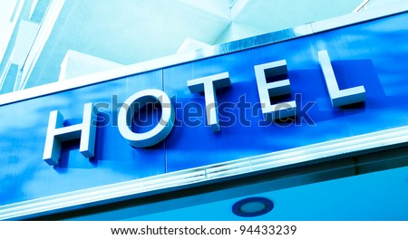 Word Hotel over new modern facade - stock photo