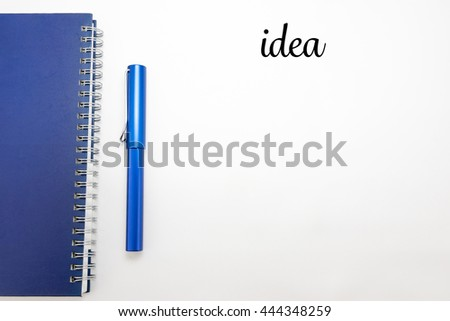 Word Idea with Notebook and pen isolated on white background