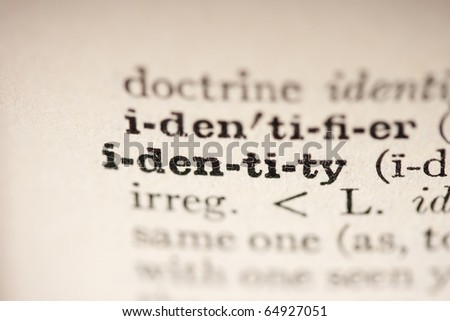 Word identity from the old dictionary, a close up. - stock photo