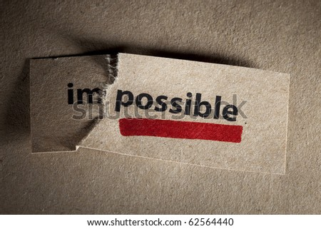 Word impossible transformed into possible. Motivation philosophy concept - stock photo
