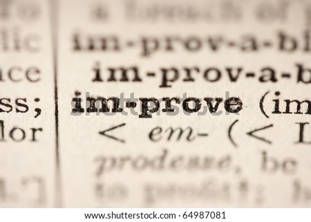 Word improve from the old dictionary, a close up. - stock photo