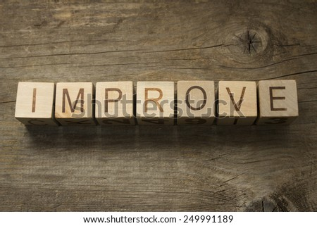 Word Improve on a wooden blocks. Motivational concept - stock photo