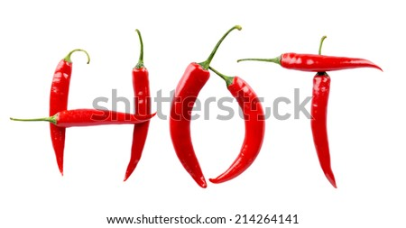 Word, inscription HOT made from red chilli peppers isolated on a white background - stock photo