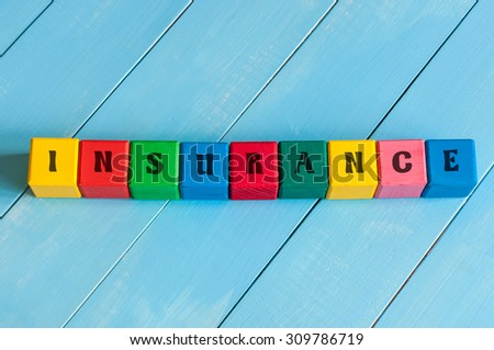 Word Insurance on children's colourful cubes or blocks. Business background. - stock photo