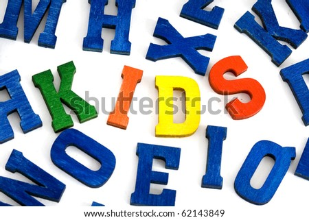 Word kids made from colorful wooden letters on white background