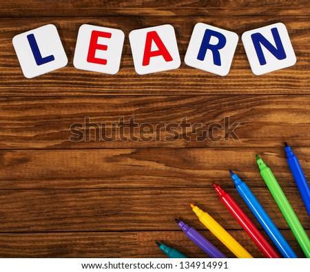 word learn on a wooden table - stock photo