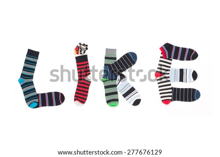 "Word ""Like"" made from colorfull socks, isolated on white.  - stock photo"