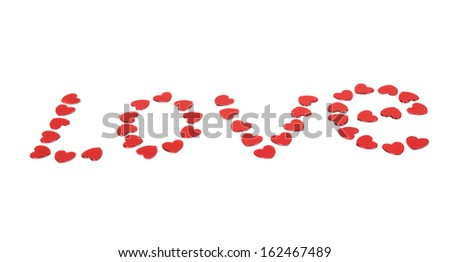 Word Love collected from small red hearts isolated on white