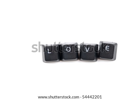 Word love composed with letters of computer keyboard isolated on white background with copy space for text message