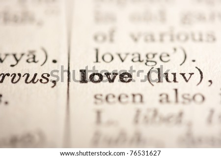 Word love from the old dictionary, a close up. - stock photo