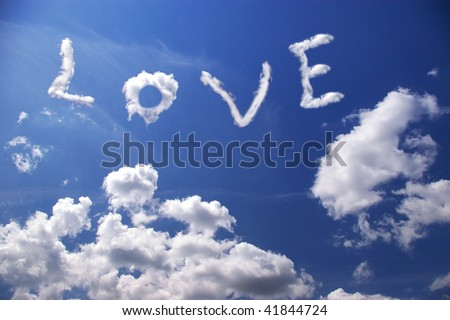 Word love in white clouds on blue sky - stock photo