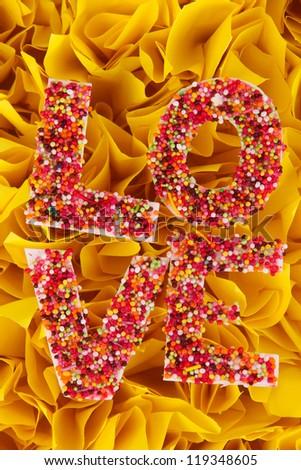 Word Love on decorative yellow background - stock photo