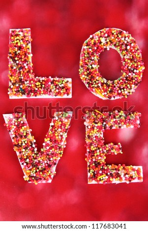 Word Love on red background - stock photo