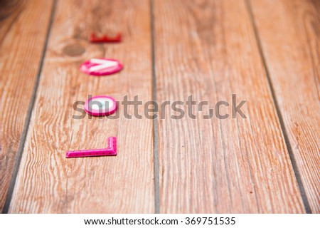 Word Love on wooden background.Sweet holiday,Happy Valentines day, wedding day, Mother's day, Anniversary for special person. Right space and text on left of frame. - stock photo