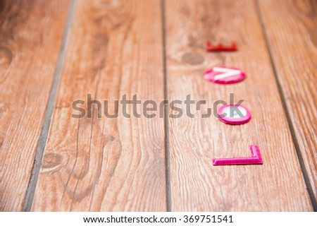 Word Love on wooden background.Sweet holiday,Happy Valentines day, wedding day, Mother's day, Anniversary for special person. left space and text on right of frame. - stock photo