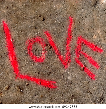 "Word ""love"" written with crayon on concrete - stock photo"
