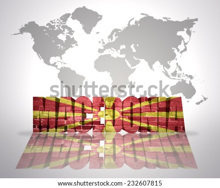 Word Macedonia with Macedonian Flag on a world map background