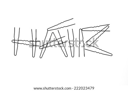 word made by hair pins on white background - stock photo