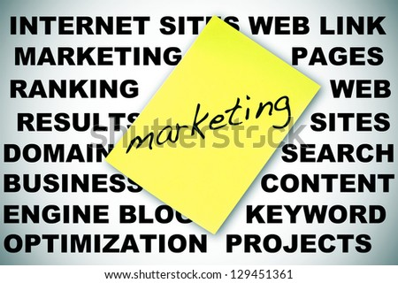 word MARKETING written in a sticky note and concepts about social engine optimization and internet subjects - stock photo